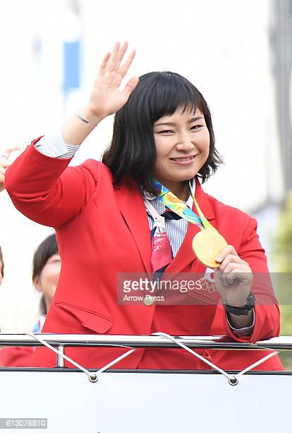 Sara Dosho waves on the top of a double decker bus during the Rio Olympic Paralympic 2016 Japanese medalist parade in the ginza district on October 7...