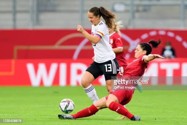 Sara Draebitz of Germany and Dejana Stefanovic of Serbia battle for the ball during the FIFA Women's World Cup 2023 Qualifier group H match between...