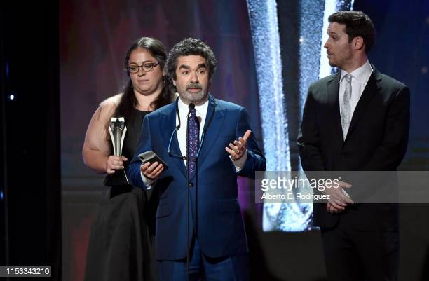 Sara Enright Joe Berlinger and Sam Broadwin accept the Best Crime/Justice Show award for 'Conversations with a Killer The Ted Bundy Tapes' onstage...