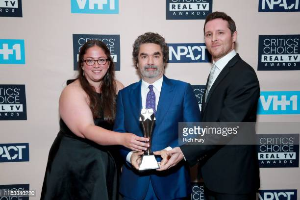 Sara Enright Joe Berlinger and Sam Broadwin winners of the Best Crime/Justice Show award for 'Conversations with a Killer The Ted Bundy Tapes' pose...