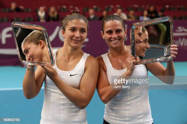 Sara Errani and Roberta Vinci of Italy hold the trophy after winning the doubles final of the Open GDG Suez 2013 at the Stade Pierre de Coubertin on...