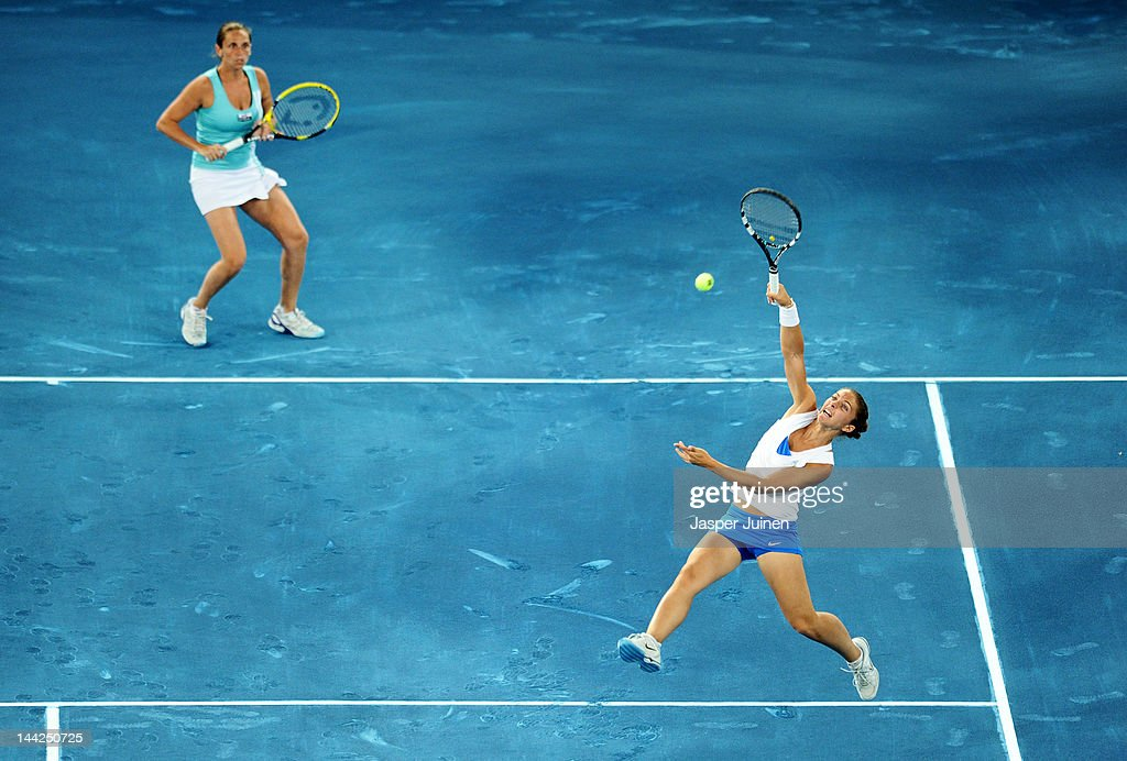 Sara Errani (L) and Roberta Vinci of Italy in action against Ekaterina Makarova and Elena Vesnina of Russia in their semi final match during the Mutua Madrilena Madrid Open tennis tournament at the Caja Magica on May 12, 2012 in Madrid, Spain.