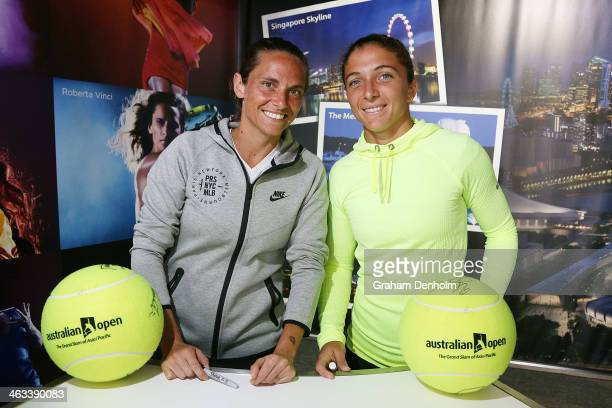 Sara Errani and Roberta Vinci of Italy pose during an autograph session at the WTA Booth during day 6 of the 2014 Australian Open at Melbourne Park...