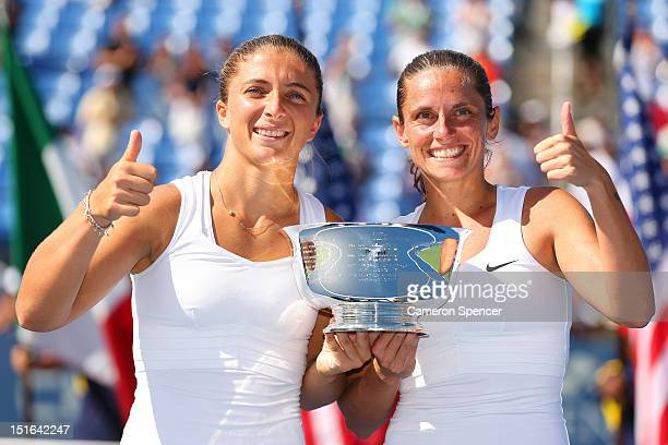 Sara Errani and Roberta Vinci of Italy pose with the trophy following their victory against Andrea Hlavackova and Lucie Hradecka of the Czech...