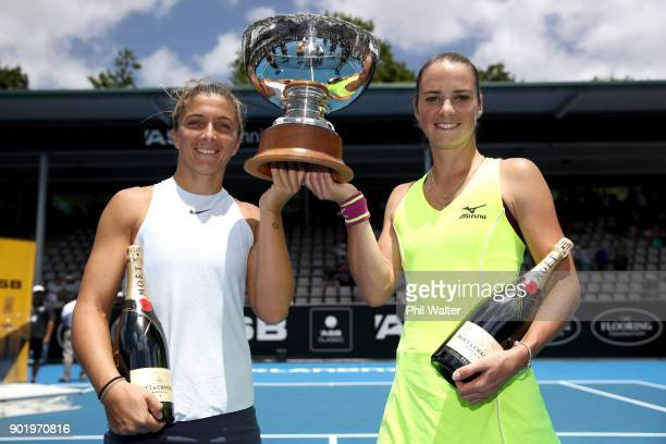 Sara Errani of Italy and Bibiane Schoofs of Netherlands pose with the trophy as they celebrate their Womens Doubles Final win against Eri Hozumi and...