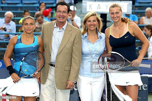 Sara Errani of Italy and Petra Kvitova of Cezch Republic pose at the net with Connecticut Governor Dannel P Malloy and New Haven Open at Yale...