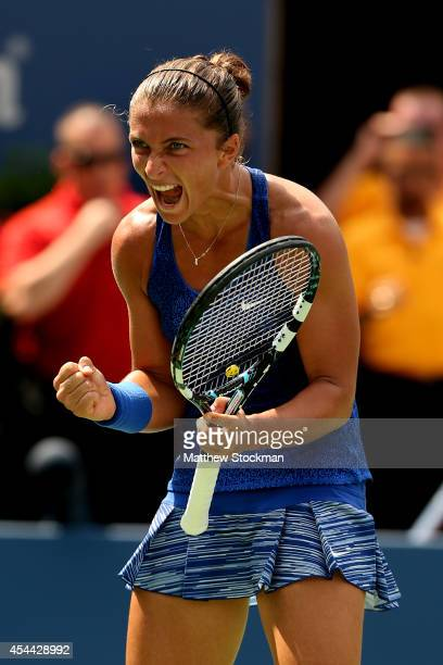 Sara Errani of Italy celebrates after defeating Mirjana LucicBaroni of Croatia in their women's singles fourth round match on Day Seven of the 2014...