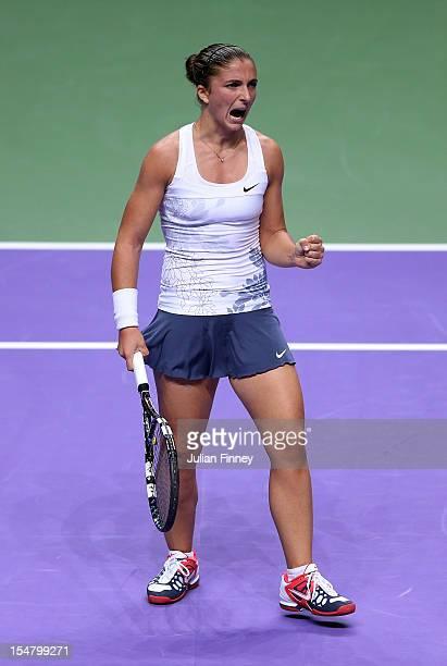 Sara Errani of Italy celebrates winning a game against Agnieszka Radwanska of Poland during day four of the season ending TEB BNP Paribas WTA...