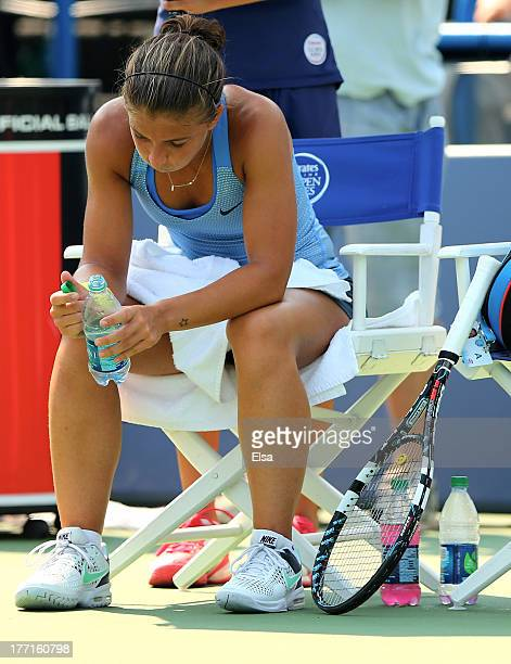 Sara Errani of Italy cools down in between games of the second set against Ekaterina Makarova of Russia during Day Four of the New Have Open at...