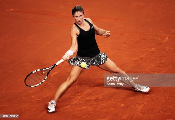 Sara Errani of Italy hits a forehand during her match against Carla Suarez Navaro of Spain on day five of the Porsche Tennis Grand Prix at Porsche...