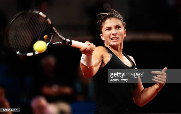 Sara Errani of Italy hits a forehand during her match against Kaia Kanepi of Estonia during day 3 of the Porsche Tennis Grand Prix 2014 at...