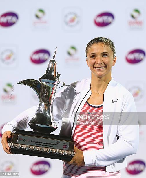 Sara Errani of Italy holds the trophy after defeating Barbora Strycova of Czech Republicduring the women's final match of the WTA Dubai Duty Free...