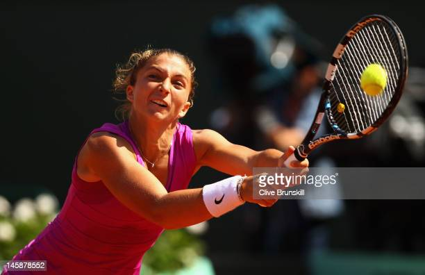 Sara Errani of Italy plays a backhand in her women's semi final match against Samantha Stosur of Australia during day 12 of the French Open at Roland...
