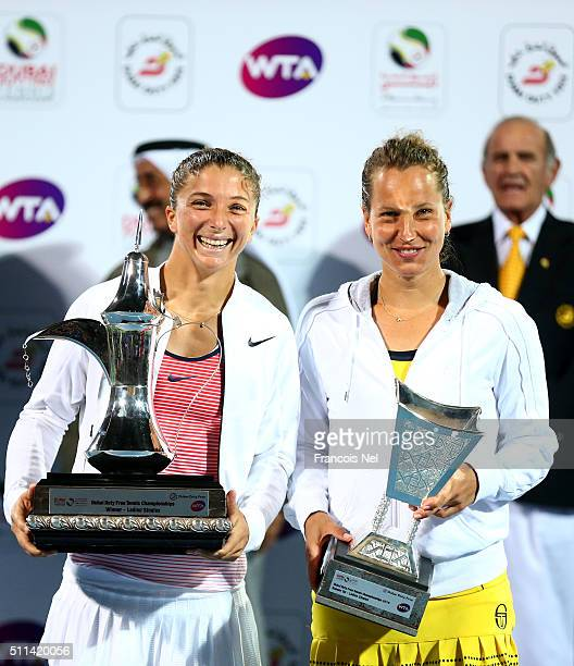 Sara Errani of Italy poses with the winning trophy and Barbora Strycova of the Czech Republic poses with her runner up trophy after the women's final...