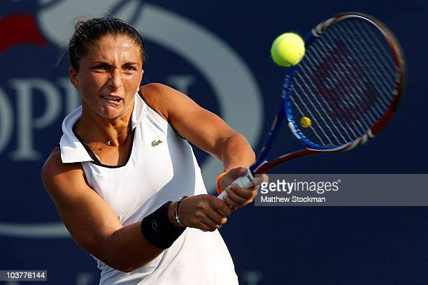 Sara Errani of Italy returns a shot against Alisa Kleybanova of Russia during her second round women's singles match on day three of the 2010 US Open...