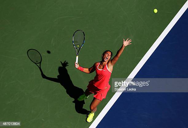 Sara Errani of Italy serves to Samantha Stosur of Australia during their Women's Singles Third Round match on Day Six of the 2015 US Open at the USTA...