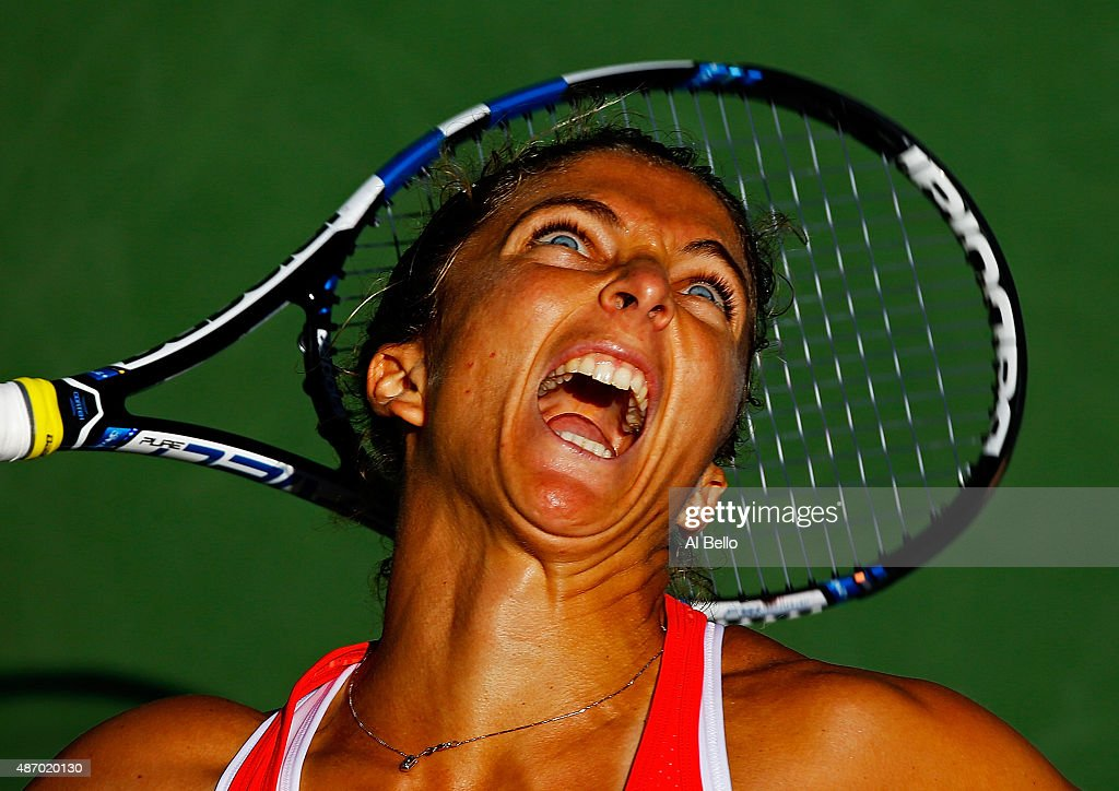 Sara Errani of Italy serves to Samantha Stosur of Australia during their Women's Singles Third Round match on Day Six of the 2015 US Open at the USTA Billie Jean King National Tennis Center on September 5, 2015 in the Flushing neighborhood of the Queens borough of New York City.