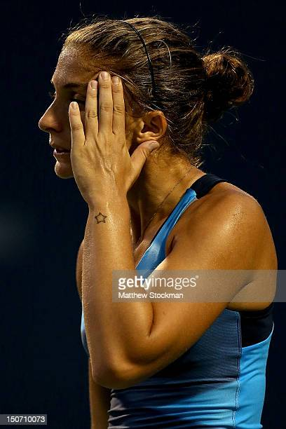 Sara Errani of Italy wipes her face between points while playing Petra Kvitova of Cezch Republic during the semifinals of the New Haven Open at Yale...
