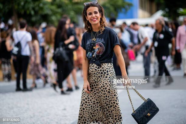 Sara Escudero wearing Chanel bag skirt with leopard print is seen during the 94th Pitti Immagine Uomo on June 13 2018 in Florence Italy