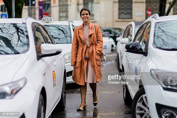Sara Escudero wearing Chanel shoes and an Armani belted coat creme Vestiaire bagseen outside Giorgio Armani during Milan Fashion Week Fall/Winter...