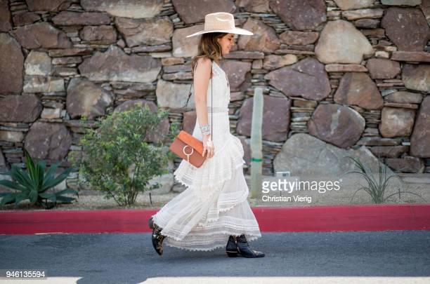 Sara Escudero wearing Chloe bag, House of Harlow dress, straw hat is seen on April 13, 2018 in Indio, California.