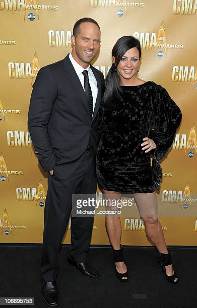 Sara Evans and Jay Barker attend the 44th Annual CMA Awards at the Bridgestone Arena on November 10 2010 in Nashville Tennessee