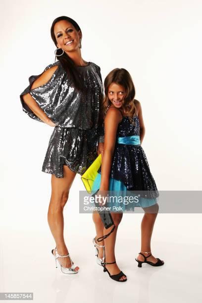 Sara Evans and Olivia Evans pose in the Wonderwallcomcom Portrait Studio during 2012 CMT Music awards at the Bridgestone Arena on June 6 2012 in...