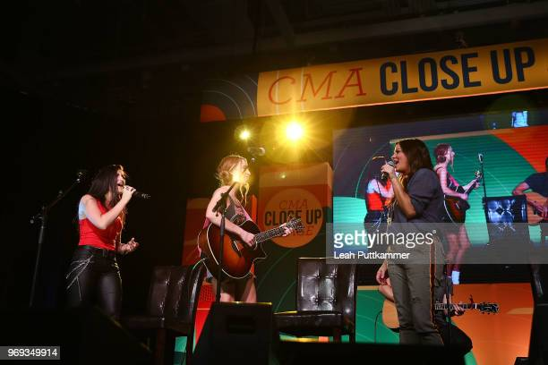 Sara Evans surprises young female country artists as they cover a Sara Evans song on the CMA Close Up Stage during the 2018 CMA Music festival at the...