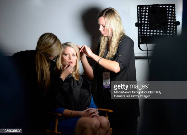 Sara Fagen with CNBC at center has her hair and makeup done by Christine Mooris left and Jess Robson before going on air inside the spin room at the...