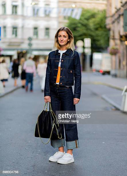 Sara Finn wearing a dark deinm jacket and jeans white tshirt and sneaker during the third day of the Stockholm Fashion Week Spring/Summer 2017 on...