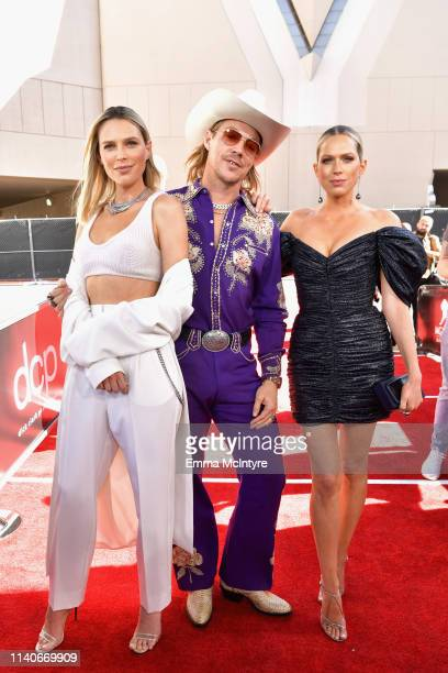 Sara Foster Diplo and Erin Foster attend the 2019 Billboard Music Awards at MGM Grand Garden Arena on May 1 2019 in Las Vegas Nevada