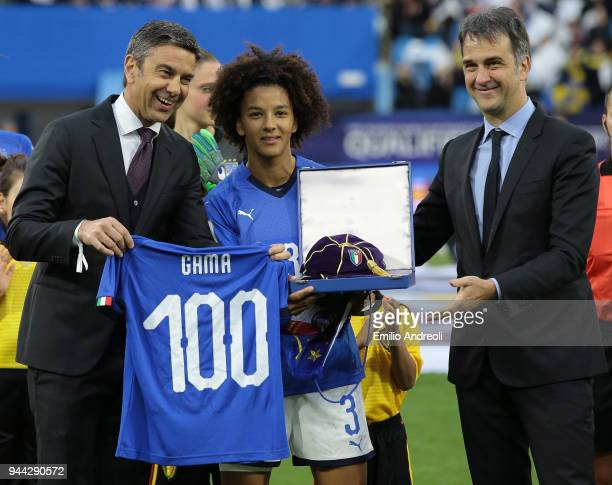Sara Gama of Italy is awarded by Vice President FIGC Michele Uva and Alessandro Costacurta prior to the FIFA Women's World Cup Qualifier between...