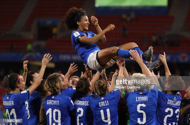 Sara Gama of Italy is thrown in the air by her teammates following the 2019 FIFA Women's World Cup France group C match between Italy and Brazil at...