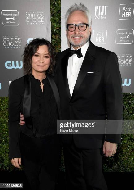 Sara Gilbert and Bradley Whitford attend the 25th Annual Critics' Choice Awards at Barker Hangar on January 12 2020 in Santa Monica California