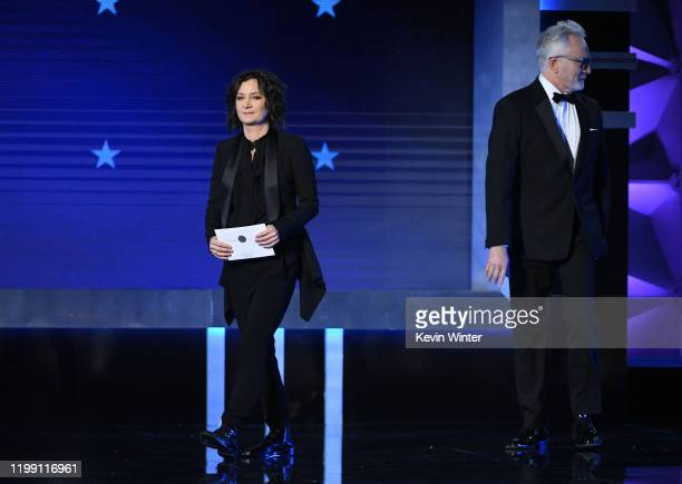 Sara Gilbert and Bradley Whitford walk onstage during the 25th Annual Critics' Choice Awards at Barker Hangar on January 12 2020 in Santa Monica...