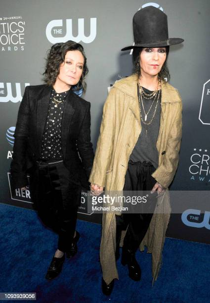 Sara Gilbert and Linda Perry arrives to Critics Choice Red Carpet Special Celebrity Guests With Host Sam Rubin on January 13 2019 in Santa Monica...