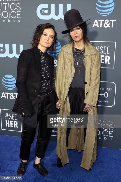 Sara Gilbert and Linda Perry attend The 24th Annual Critics' Choice Awards at Barker Hangar on January 13 2019 in Santa Monica California