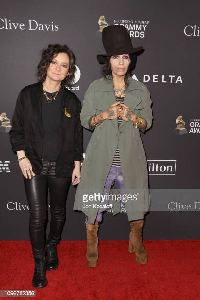 Sara Gilbert and Linda Perry attend The Recording Academy And Clive Davis' 2019 PreGRAMMY Gala at The Beverly Hilton Hotel on February 9 2019 in...