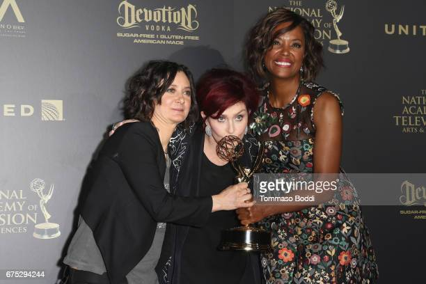 Sara Gilbert, Sharon Osbourne and Aisha Tyler pose in the Press Room during the 44th Annual Daytime Emmy Awards at Pasadena Civic Auditorium on April...