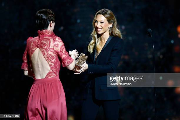 Sara Giraudeau receives from Laura Smet the Best Second Role Actress Award for the movie Petit Paysan uring the Cesar Film Awards 2018 at Salle...