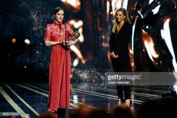 Sara Giraudeau receives from Laura Smet the Best Second Role Actress Award for the movie 'Petit Paysan' uring the Cesar Film Awards 2018 at Salle...