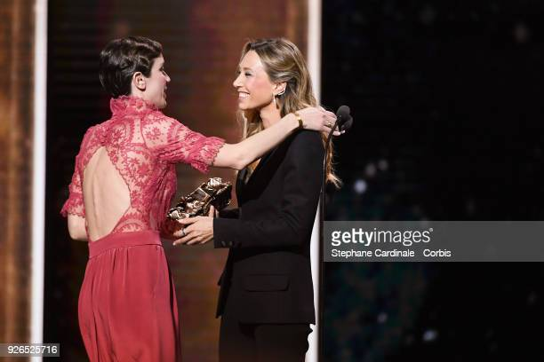 Sara Giraudeau receives from Laura Smet the Best Second Role Actress Award for the movie 'Petit Paysan' during the ceremony of the Cesar Film Awards...