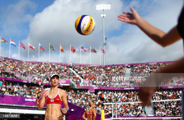 Sara Goller of Germany prepares to serve during the Women's Beach Volleyball Round of 16 match between Germany and Germany on Day 7 of the London...