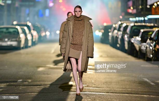 Sara Grace Wallerstedt walks along 46th Street during the Michael Kors Fashion Show in Times Square on April 08, 2021 in New York City.
