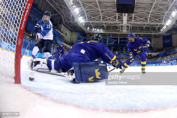 Sara Grahn of Sweden gives up a goal to Petra Nieminen of Finland in the first period during the Ice Hockey Women's Playoffs Quarterfinals on day...