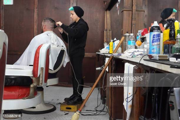 Sara Gumbiner gives a haircut to Scott Watson at Gatsby's Barber Shoppe and Shave Parlor on May 13, 2020 in Chesterton, Indiana. Recently, Indiana...