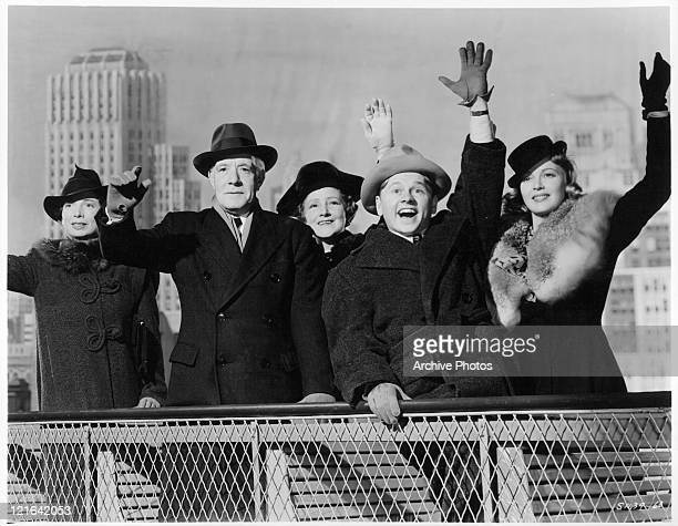 Sara Haden Lewis Stone Fay Holden Mickey Rooney and Cecilia Parker wave in a scene from the film 'Andy Hardy Meets Debutante' 1940