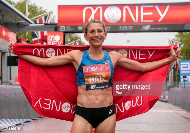 Sara Hall of The United States of America celebrates second place in the Elite Women's Field during the 2020 Virgin Money London Marathon around St...