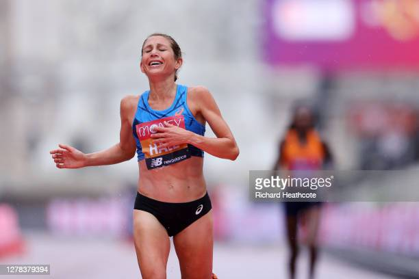 Sara Hall of The United States of America crosses the finish line in second place ahead of Ruth Chepngetich of Kenya in the Elite Women's Field...