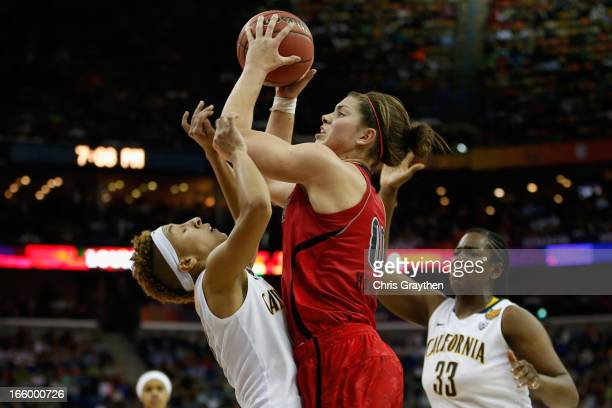 Sara Hammond of the Louisville Cardinals shoots the ball over Layshia Clarendon of the California Golden Bears during the National Semifinal game of...